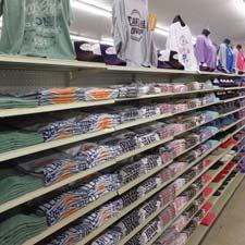 Shelf full of Clear Lake Apparel