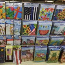 Shelf filled with assorted flags